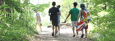 Young campers hiking down the trail.