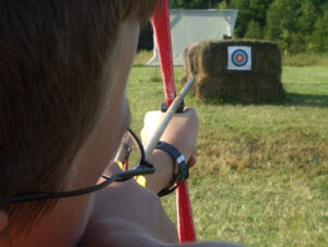 View of archery target a from over the shoulder of the archer, with arrow aimed at target