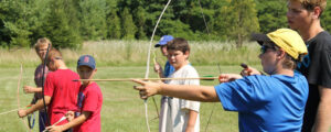 camper learning archery at Camp Huron