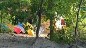beach hut and canoes amongst the trees