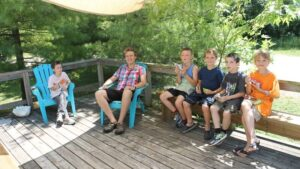 Group of youg campers on the deck with staff member