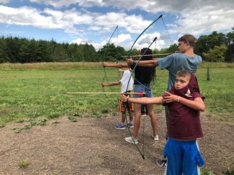 Young campers learning archery